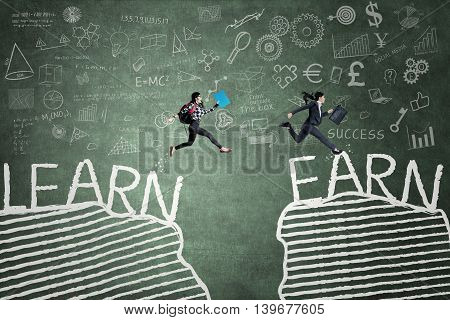 Female student jumps from the word of learn while the businesswoman jumps from the word of earn