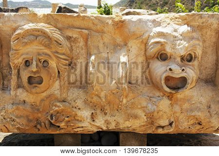 face on the stone bas-reliefs in the ancient city Myra Turkey