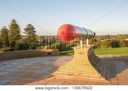 FREMANTLE,WA,AUSTRALIA-JUNE 25,2016: Naval memorial with red-tipped torpedo on stone at Monument Hill in Fremantle, Western Australia.