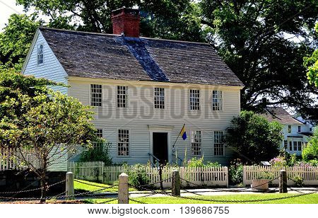 Mystic Connecticut - July 11 2015: 1768 Buckingham Hall wood frame Georgian colonial home at the Mystic Seaport Museum