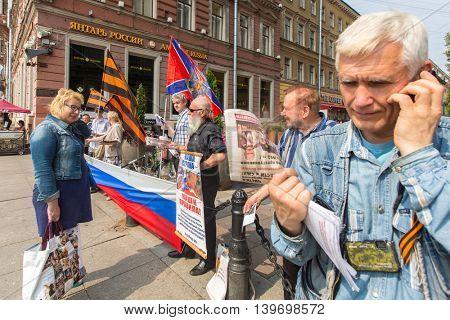 St.PETERSBURG, RUSSIA - JULY 24, 2016: Activists of the pro-Putin anti-western organization NLM SPb (National Liberation movement), on the Nevsky Prospekt.