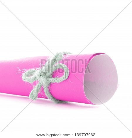 Handmade natural string bow tied on pink paper roll, isolated