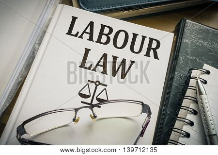 Labour Or Labor Law Book. Legislation And Justice Concept.