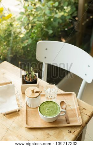 Hot Green Tea Set On A Wooden Table In A Coffeshop