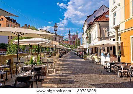 Ljubljana riverfront promenade walkway summer view capital of Slovenia