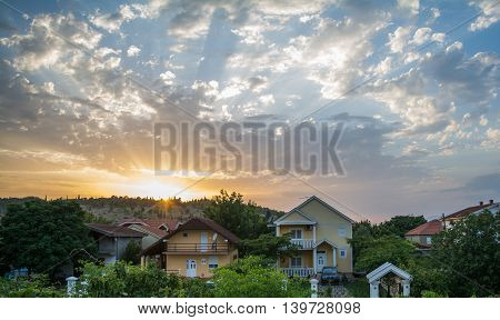 Neighbourhood houses in beautiful colorful cloudy sunset