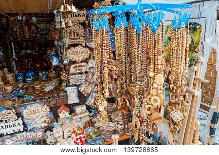 VELIKY NOVGOROD RUSSIA-JULY 22 2016. Souvenir trade - wooden bead jewelry and various souvenir objects made of wood in traditional Russian style.