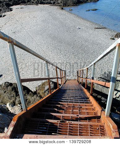 Steep Steps looking downward at low tide onto a sand bar.