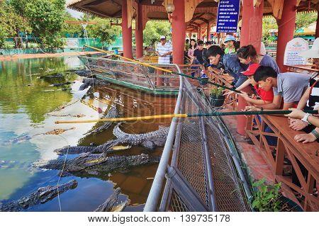 Ho Chi Minh city ( Saigon ) Vietnam - September 02 2015: People have fun - feed crocodiles in historical theme adventure park and children water park Suoi Tien - Vietnam popular travel destination.