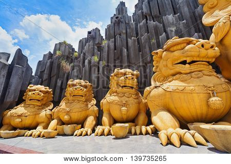 Ho Chi Minh city ( Saigon ) Vietnam - September 02 2015: gold dragons statues in children water park and historical theme amusement park Suoi Tien - popular travel destination in south Vietnam .