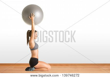 Fit Woman Holding A Pilates Ball