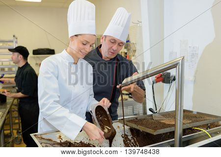commis chef and cook chef at the indoor restaurant service