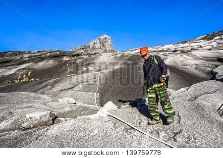 Ranau,Sabah,Malaysia-March 13,2016:Undentified climbers move down to Laban Rata after succesfully completed conquering the mountain Kinabalu.