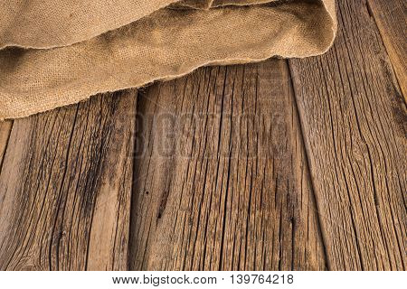 Burlap texture on wooden table background Burlap texture on wooden table background