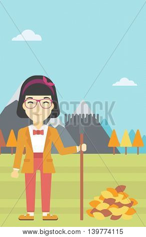 An asian young woman raking autumn leaves. Woman with rake standing near tree and heap of autumn leaves. Woman tidying autumn leaves in garden. Vector flat design illustration. Vertical layout.