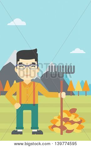 An asian young man raking autumn leaves. Man with rake standing near tree and heap of autumn leaves. Man tidying autumn leaves in garden. Vector flat design illustration. Vertical layout.