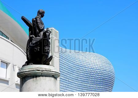 BIRMINGHAM, UNITED KINGDOM - JUNE 6, 2016 - View of the Selfridges building in the Bullring with a statue of Nelson in the foreground Birmingham England UK Western Europe, June 6, 2016.