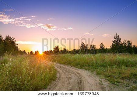summer rural landscape with blue sky the road. sunrise