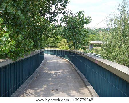 Pedestrian Bridge With A Round Spiral Acces