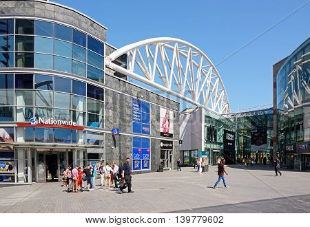 BIRMINGHAM, UNITED KINGDOM - JUNE 6, 2016 - Shoppers near the entrance to the Bullring shopping centre Birmingham England UK Western Europe, June 6, 2016.