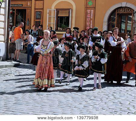 CESKY KRUMLOV, CZECH REPUBLIC - JUNE 18, 2016: Five-petalled Rose Festival on bystreet in Cesky