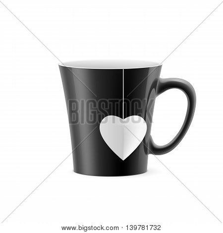 Black cup with tapered bottom with a tea bag in the form of heart