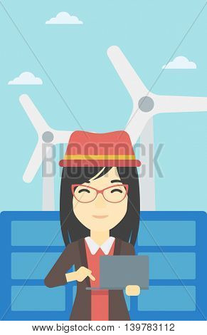 An asian female worker of solar power plant and wind farm. Woman working on laptop on a background of solar power plant and wind turbines. Vector flat design illustration. Vertical layout.