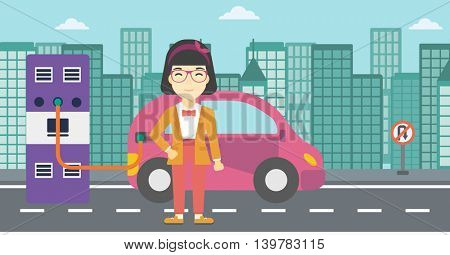 An asian young woman charging electric car at charging station in the city. Woman standing near power supply for electric car charging. Vector flat design illustration. Horizontal layout.
