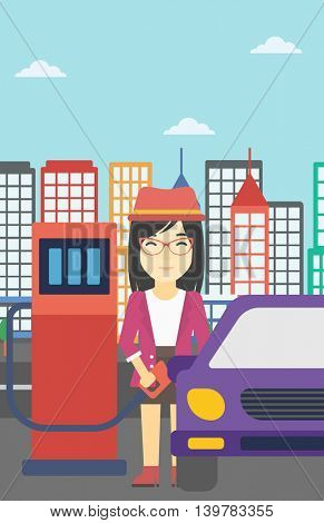An asian woman filling up fuel into the car. Woman standing at the gas station and refueling a car. Vector flat design illustration. Vertical layout.