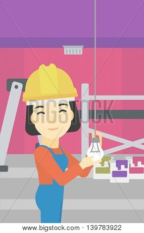 An asian female electrician twisting a light bulb. An electrician installing light in an apartment. Electrician changing light bulb. Vector flat design illustration. Vertical layout.