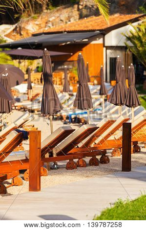 Luxury beachfront complex with sun loungers and umbrellas on the Adriatic coast. Dubrovnik, Croatia.