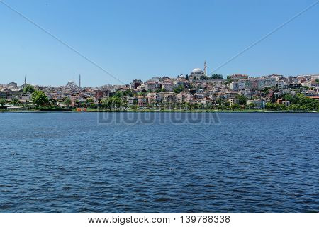 distant shore of Istanbul with hills and houses. with sea view.