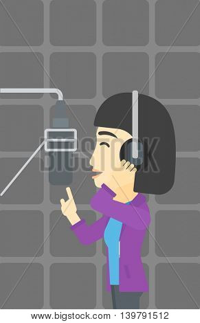 An asian young woman in headphones singing in recording studio. Singer making a record of her voice. Young singer recording a song. Vector flat design illustration. Vertical layout.