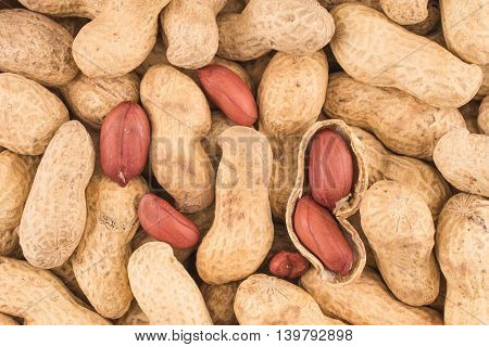 Many peanuts in shells one upon the other