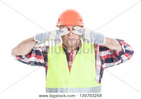 Male Builder Making The See No Evil Gesture