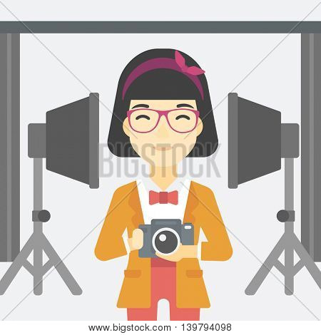 An asian young photographer holding a camera in photo studio. Photographer using camera in the studio. Woman taking photo with digital camera. Vector flat design illustration. Square layout.
