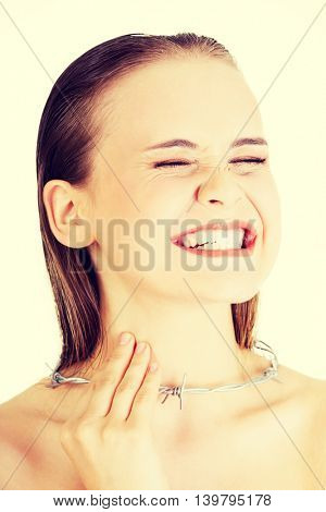 Throat pain concept. Young woman with barbed wire around her thr
