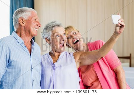Seniors taking a selfie in a retirement home