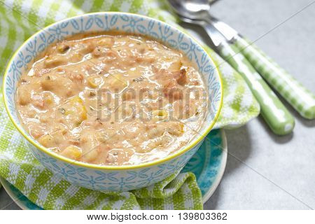 Salmon chowder soup with cream, potatoes, carrots and dill