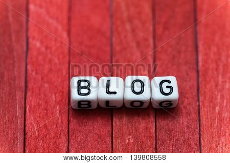 Blog Cube Blocks Arranged On Red Wooden Background
