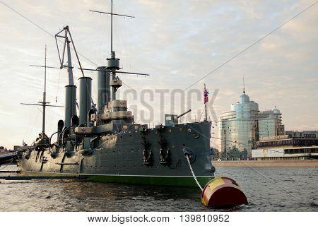 ST. PETERSBURG, RUSSIA - JULY 19, 2016: Russian cruiser Aurora moored at the embankment of Nevka river. The ship has been overhauled and returned from the shipyard on July 16