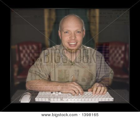 Happy Man On His Computer At Home