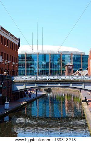BIRMINGHAM, UNITED KINGDOM - JUNE 6, 2016 - View along the canal at Old Turn Junction towards the National Indoor Arena aka the Barclaycard Arena Birmingham England UK Western Europe, June 6, 2016.