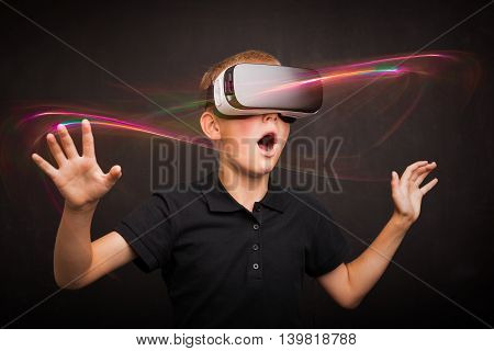 Boy experiencing virtual reality with digital glasses