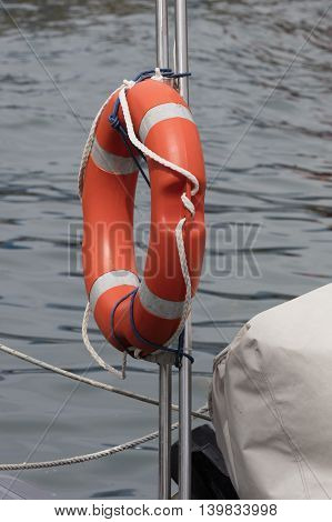 lifebelt on boat at lake in summer