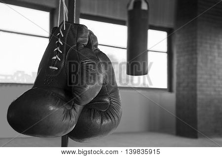 Boxing gloves in a gym on a distance shot punching bag