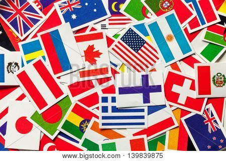 National flags of the different countries of the world in a heap. Top view