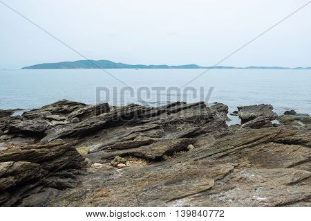 Rock on sea coastline with seascape view at Mu Ko Samet National Park in the Gulf of Thailand.