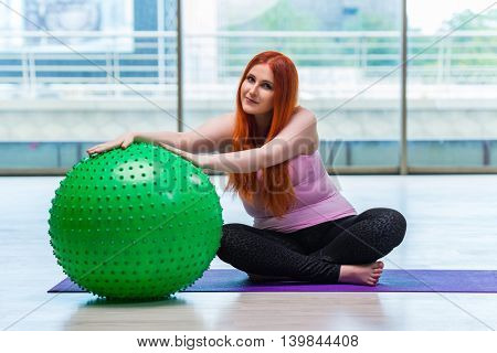 Woman working with swiss ball in the studio