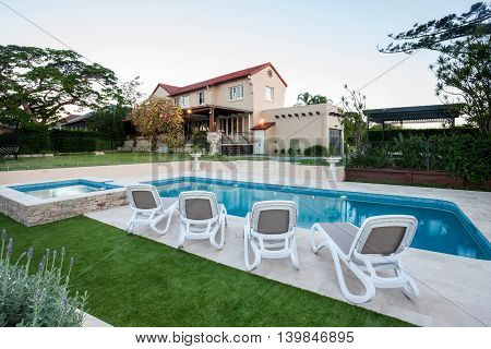 Modern Pool In Front Of The House With A Lawn